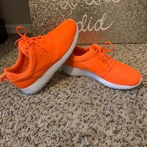 Orange Nike Roshe sneakers
